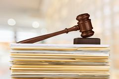 Judge hammer and documents on background. Hammer documents judge background object isolated brown stock image