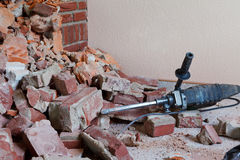 Hammer drill and rubble Royalty Free Stock Image