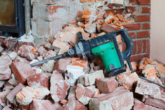 Hammer drill and rubble Royalty Free Stock Images