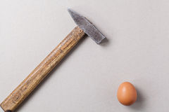 Hammer and egg Stock Photography