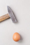 Hammer and egg Royalty Free Stock Images
