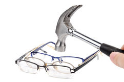 Hammer and eye glasses Royalty Free Stock Photo