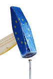 Hammer with flag of the european union hitting a rusty nail,  me Stock Photos