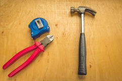 Hammer, flat nose pliers, tape measure Royalty Free Stock Photo