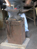 Hammer Forging Link. Blacksmith forges link on anvil royalty free stock images