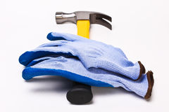 Hammer and gloves. On white background Stock Images