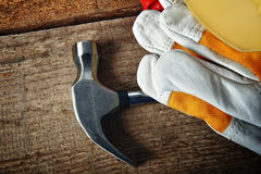 Hammer and gloves Royalty Free Stock Photos