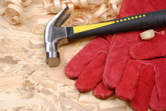 Hammer, gloves and chips Royalty Free Stock Image