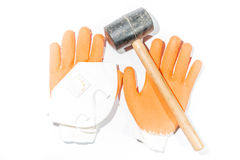 Hammer, gloves and dust mask Stock Photo