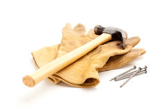 Hammer, Gloves and Nails Royalty Free Stock Photography
