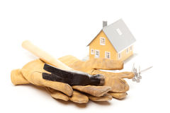 Hammer, Gloves, Nails and House Royalty Free Stock Images
