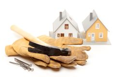 Hammer, Gloves, Nails and House royalty free stock photos