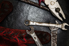 Hammer, gloves and wrenches. On a dark background Stock Image