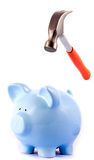 Hammer going to Smash Piggy Bank Royalty Free Stock Images