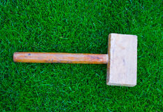 Hammer on green grass. Hammer on a green grass Royalty Free Stock Photo