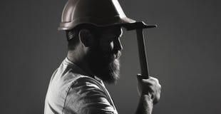 Hammer hammering. Builder in helmet, hammer, handyman, builders in hardhat. Handyman services. industry, builder man royalty free stock images