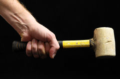 Hammer and a Hand Stock Images