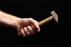 Hammer and a Hand Royalty Free Stock Photos