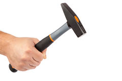Hammer in hand on white background. Stock Photos