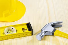 Hammer hardhat construction level Stock Image