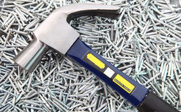 Hammer on heap of Silver nails Stock Photos