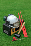 Hammer, helmet, wrench, screwdriver and toolbox on grass field Stock Photos