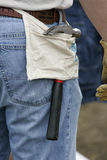 Hammer on Hip. Construction worker with hammer in a work apron Stock Image