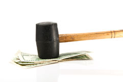 Hammer hit dollars Royalty Free Stock Photo