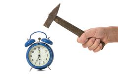 Hammer hits alarm clock Royalty Free Stock Images