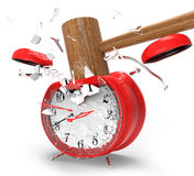 Hammer hitting an alarm clock. Stock Image