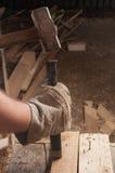 Hammer hitting a chisel. Carpenter at work using a hamer hitting a chisel stock image