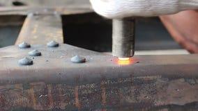 Hammer hitting hot rivet stock footage