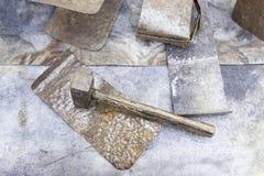Hammer hitting metal Stock Images