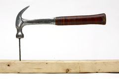 Hammer hitting a nail Royalty Free Stock Photography