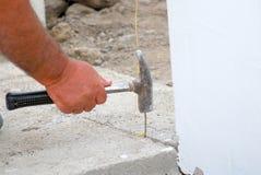 Hammer hitting a nail Stock Image