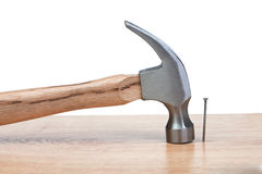 Hammer hitting a nail into a wood royalty free stock photo