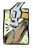 Hammer hitting a nail into wood Stock Photography