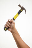 A hammer holding by a hand. A man hand holding a hammer Stock Image