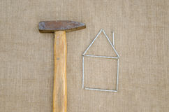 Hammer and house made nail building home concept Stock Images