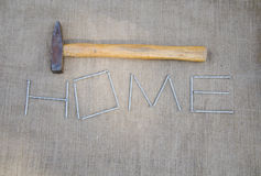 Hammer and inscription of nails on linen texture Royalty Free Stock Photography