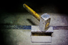 Hammer on iron anvil. Old hammer on iron anvil Stock Photography