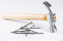 Hammer with its nails Stock Photo