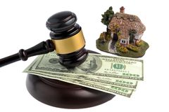 Hammer of judge with dollars and model of house isolated on whit