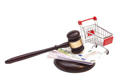 Hammer of judge, pushcart and euro money Stock Photos