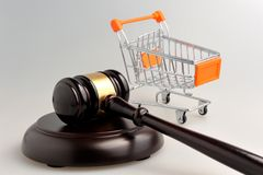 Hammer of judge and pushcart on gray Royalty Free Stock Images