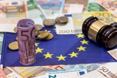 Hammer of judge to the European flag. On the background of the euro Stock Image
