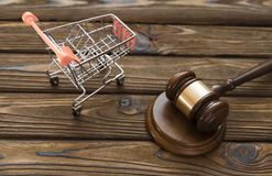 Hammer of the judge, a trolley from a supermarket royalty free stock images