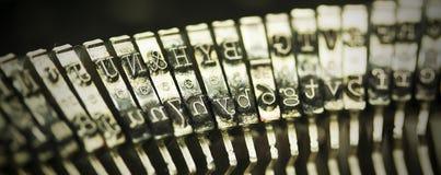 Hammer keys on an old type writer. Vintage filter. Stock Photos