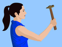 Hammer lady. Young lady with a hammer in hand on blue Royalty Free Stock Image