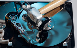 Hammer lies on damaged hard drive Stock Photography
